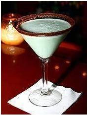 Dirty Girl Scout...1¼ oz White Choc Liqueur, 1¼ oz Dark Choc Liqueur, 1½ oz Vanilla Vodka, ½ oz Dark Green Cream de Mint, splash Cream. Rim martini glass choc powder. Shake, strain in glass.