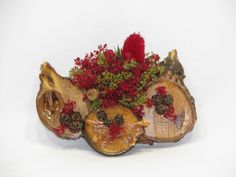 """Little Life - 2012 #220 Don't let this """"Little"""" sculpture fool you. It is full of """"Life""""! These wood slices form the background for a lively display of sesame bloom, pods, nut shells, & bark chips. 5.5"""" w x 1.5"""" d x 4.5"""" h 3 oz"""