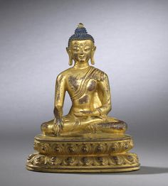 A rare early gilt-bronze seated Buddha Tibetan, 15th century