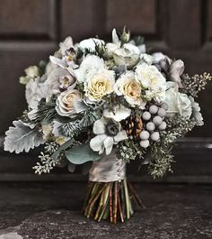 Winter wedding bouquet of mini cymbidium orchids silver brunia juniper pine boughs anemones pine cones garden spray roses seeded eucalyptus Vendela roses and dusty miller - March 02 2019 at Silver Winter Wedding, Winter Wedding Flowers, Diy Winter Weddings, Autumn Wedding, Winter Flowers In Season, Small Winter Wedding, Winter Wedding Decorations, October Wedding, Decor Wedding