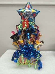 Made my first candy/treat bouquet for my fiancés birthday.