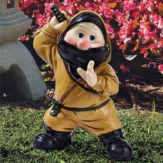 Ninja Garden Gnome. It's a pretty deadly and cute little gnome that has struck a ninja pose to scare away intruders!The stealth outfit and sword make him seem fearsome in a comical way. This gnome believes in no fairytales, he only believes in combat and protecting his precious garden!