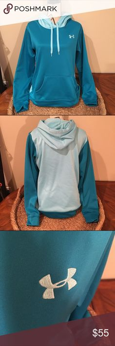 SALE Under Armour blue sweatshirt It has been worn a couple times. In great condition. It is almost a turquoise color and then back is a lighter turquoise color. Under Armour Tops Sweatshirts & Hoodies