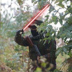 My airsoft buddy Diesel, using a lightsaber as a machette lol.