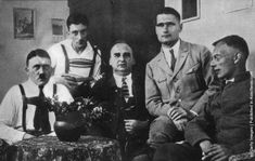 Adolf Hitler receives visitors, including Rudolf Hess (1894–1987), (second from right), during his imprisonment in Landsberg jail. (Photo by Topical Press Agency/Getty Images). December 1924