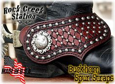 Buckhorn Spur Straps Handmade Leather  • FREE SHIPPING within the U.S. • Fully Lined • Covered Spur Buttons • Diamond Cut Pattern • Engraved Square Buckle • Mexican Berry Conchos at both ends  THESE SPUR STRAPS ARE A BUILD TO ORDER ITEM. PLEASE INQUIRE FOR CURRENT BUILD TIME.  They are fully lined and feature 1 1/2 antiqued Mexican berry conchos on the outside and 1 1/4 on the buckle end. The buckle end is full covered so that the spur button does not show. The body of these straps are…