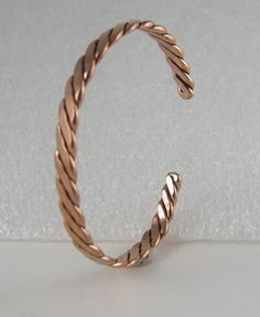 Check out this item in my Etsy shop https://www.etsy.com/listing/234551092/bracelet-twisted-copper-heavy-14-gauge