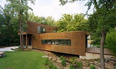 L-Stack House - Fayetteville, Ark.  Two independent boxes linked by a glass-enclosed staircase. That's how architect Marlon Blackwell of Fayetteville describes his L-shaped contemporary home built over a crawfish-stocked creek on a trapezoid-shaped lot not far from a city park.