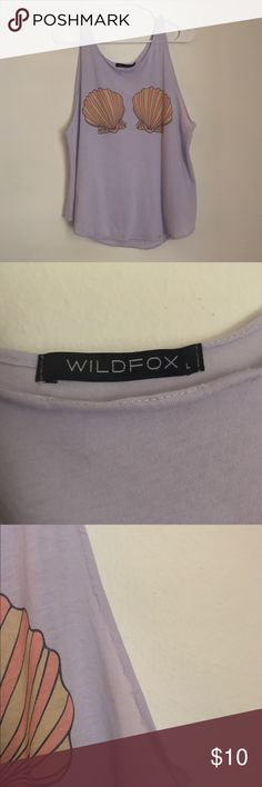Wildfox tank Lavender/light purple wildfox tank size large. Very used! Has some unstitching & small stain as seen on pictures. That's why selling so cheap! Wildfox Tops Tank Tops