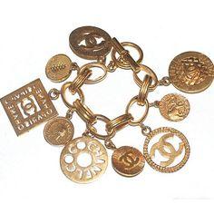 Chanel Gold Tone Medallion Charm Bracelet | Portero Luxury
