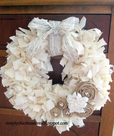 Muslin Rag Wreath   I did thi out of all burlap on a foam wreath form  embellished with country looking wood ornaments    Then I did one with a grapevine wreath and made burlap rosettes and hung an acorn bell on center. Both were so pretty