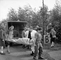 MAY  6 1945 Eisenhower refuses to allow any more German delays - See more at: http://ww2today.com/German workers assist with the movement of typhus cases from Sandbostel Concentration Camp to 10 Casualty Clearing Station, which is located close to the camp.
