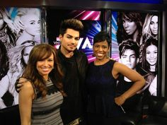 Adam Lambert, an American singer, songwriter, and stage actor, appeared on New York Live in December 2012. Adam is standing between Sara Gore on the left and Jacque Reid on the right, both co-hosts of New York Live.