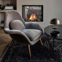 Cozy up in a Swoon lounge chair dressed in smooth velvet - found at the newly refurbished Mauritzhof Hotel in Münster, Germany. Interior concept by Lambs and Lions. Photo: Steve Herud