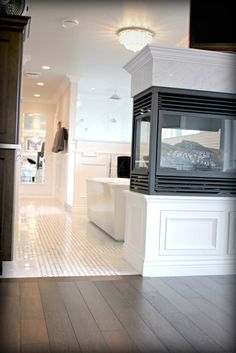 Gas Fireplace Leading To Ensuite Bathroom With Basketweave Marble Tile