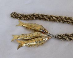 A lovely Vintage Gold Filled 35 Rope Chain with 3 Metal Articulated Fish Charms/Pendants Please look at all pictures Size: Fish Charms/Pendants: L 2.5 W .5 Rope Chain: L 35 W .25 Condition: Great condition for vintage age Age: c.1980s