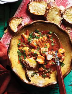 Pushed for time but needing comfort? This Mediterranean fish stew with cheese toasts makes the perfect meal to curl up on the sofa with after a cold day. Fish Recipes, Seafood Recipes, Cooking Recipes, Healthy Recipes, Healthy Dinners, Cooking Ideas, Mediterranean Fish Stew, Mediterranean Recipes, Sainsburys Recipes