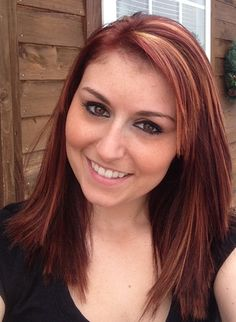 Red hair with highlights, maybe not blonde highlights but something different, love this though