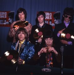 :: Mick Jagger , Charlie Watts, Keith Richards, Brian Jones, and Bill Wyman of the Rolling Stones pose with gold discs at a press conference at the Stadthalle, Bremen in Germany on March 29, 1967. The Stones' 1967 album, Between the Buttons, included the hit songs 'Let's Spend the Night Together' and 'Ruby Tuesday,' a No. 1 hit on Billboard's Hot 100 chart. The album went gold, landing at No. 2 on the Billboard 200 ...