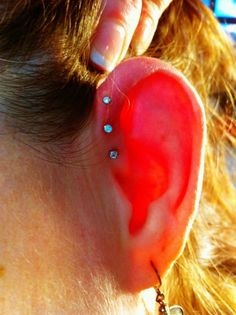 Triple Forward Helix body piercing In Living Color Tattoo