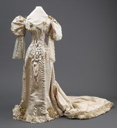 The wife of Sir Arthur Atkinson of Hull wore this dress at the couple's wedding in 1892. The dress was made by Mme Clapham;  she was Hull's most famous dressmaker.