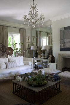 Living Room - white couch, chandelier, mirror..