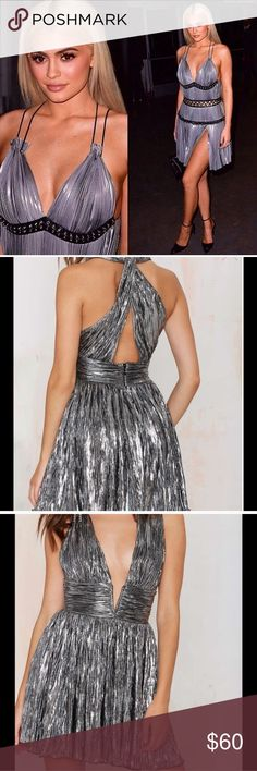 Nasty Gal silver metallic dress, Kylie dupe Perfect for New Years! Criss cross in back. Similar to what Kylie has worn 💖 Nasty Gal Dresses