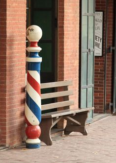 Barbering, my past life!  I LOVE this old barber pole!