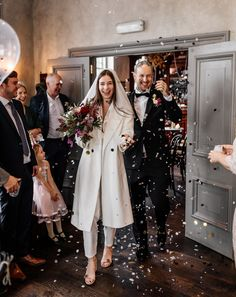 Bride in White Coat for Pub Wedding in Brighton | By Epic Love Story | Micro Wedding | Intimate Wedding | Small Wedding | 2020 Wedding | Registry Office Wedding | Pub Wedding | Stylish Wedding | Cool Bride and Groom | First Look at Wedding | Tattooed Bride | Tattooed Groom | Bridal Jumpsuit | Alternative Wedding Dress | Wedding Bouquet | Wedding Flowers