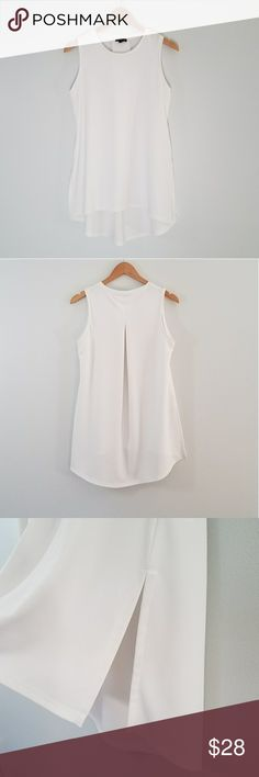 "The Limited white sleeveless tunic size medium The Limited white sleeveless tunic. Semi sheer textured material. High scoop neck, middle pleat on back. Measurements are approx 36"" bust, 27"" length from top of shoulder to bottom hem in front, 31"" length from top of shoulder to bottom hem in back. 9"" slits on the sides. Excellent used condition. The Limited Tops Tunics"