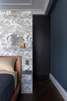 Try a cloud print behind your headboard. A gray and white cloud wallpaper like the pattern used by TFAD Architects in this Sydney, Australia, home is perfect for the bedroom; it provides a tranquil vibe.