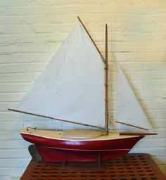 """""""Friendship sloop builder Allan Vaites turns out fetching fiberglass """"miniature"""" Friendship sloop models with the same care for detail that marks his larger boat.""""Mattapoisett, Mass."""