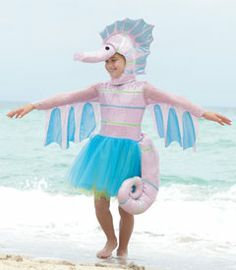 """sparkly seahorse girls costume - Only at Chasing Fireflies - Transform into an enchanting seahorse with this unique costume. Pink sequins sparkle on your dress and headpiece. Green and blue tulle make a graceful skirt, which has an attached tail fin that curves gently around back. Scalloped edges, sea-colored trim and a long snout create a whimsical headpiece. Everyone will want to """"sea"""" your amazing costume!"""