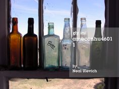 High-Res Stock Photography: Colorado Genoa Bottles line the windows of…