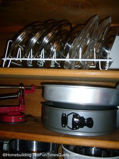 Aha! Pots and pans lid storage idea - FunTimesGuide.  So THIS is what I'm supposed to do with the short shelf over the pot shelf.