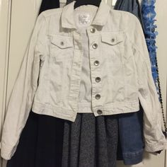 White denim jacket from Justice This jacket has been worn a couple of times. I had purchased this at Justice. It is a size 14 in girls. Buttons and everything is still in tact. There are a few little strings on the bottom button hole. I am willing to negotiate. Will model of asked  Justice Jackets & Coats Jean Jackets