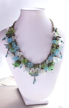 Statement Necklace, Lucite Flower Necklace, Floral Charm Necklace, Botanical, Aqua Blue, Leaf Green, White, Summer Accessories, OOAK. $96.00, via Etsy.