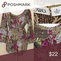 🛍CATO Fashion Camo Elastic Waist tunic top Elastic waistband tunic top cute little buttons and modest sequin embellishments and bell sleeves Cato Tops Tunics