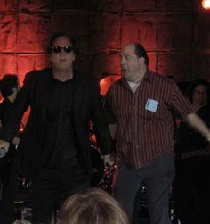 Actor Marc Raco on stage with Jim Belushi