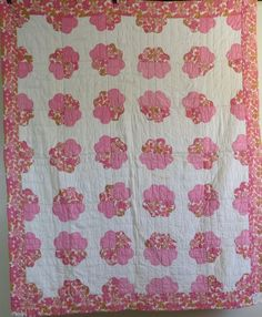 Lovey Pink and White applique quilt, cotton fabrics and machine applique, cotton batting, rolled from the front and attached to the back. For display or to use. Another delightful handmade quilt from the Ozarks!