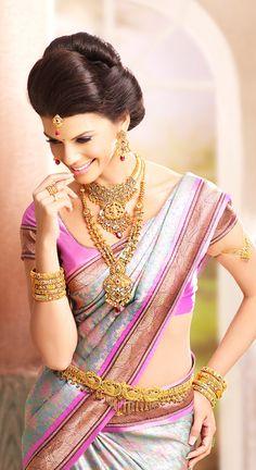 South Indian bride. Gold temple jewelry. Jhumkis.Pink silk kanchipuram sari.Bun.Tamil bride. Telugu bride. Kannada bride. Hindu bride. Malayalee bride.Kerala bride.South Indian wedding