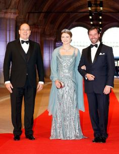 Hereditary Grand Duke Guillaume and Hereditary Grand Duchess Stephanie of Luxembourg, wearing Elie Saab, and Albert II, Prince of Monaco attend a dinner at the National Museum (Rijksmuseum) in Amsterdam hosted by Queen Beatrix of the Netherlands on the eve of her abdication.