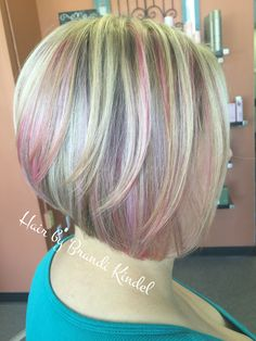 Beautiful change in color and cut for Renee today!!!  Switched her style to a soft ALine after retouching her highlights the adding some joico Soft Pink and custom mixed lavender!  first time with vivid color for Renee, she loved it and so do I!!!