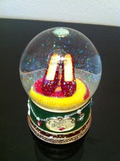 Wizard of Oz's Red ruby slippers snow globe.