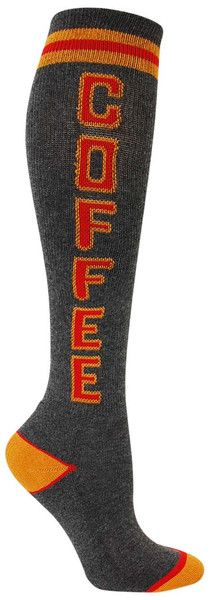 Charcoal knee high socks with COFFEE in red and tan lettering, and a cushioned footbed. Unisex design: fits a women's shoe size 7 - men's 13.5.