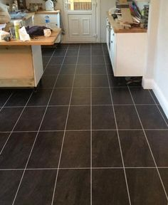 Kitchen flooring in Colonia Welsh Raven Slate 4535 and Silver 0025 feature strip (S and M Flooring)