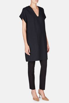 Distinguished by its easy, pull-on shape, this v-neck tunic from Vince is truly seasonless, able to transform from top to dress. Blocked seam details give a relaxed, rolled-sleeve effect to the crisp yet beautifully draping woven body, which is finished with on-seam side pockets.