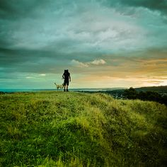 Man / Dog / Sunset: I shot this landscape image last night at the top of Mt Albert in New Zealand. I went for a walk and at the hilltop I saw this hiker and his dog, I really liked the natural green grass surroundings. Check out my Lightroom blog for before