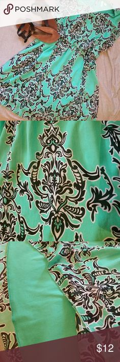 Gorgeous mint dress EUC This dress is beautiful! Perfect for work, date night, or any other occasion! Lovely mint green with black and white arabesque pattern. Fully lined with elastic at the waist. It's in excellent condition! Dresses Mini
