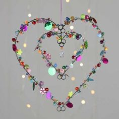 Cute Valentine Heart Decoration Ideas To Makes Your Home Cozier 41 - DecoralinkAre you interested in our Valentine star heart hanging decorations? With our hanging heart decoration for valentine you need look no further.**Stunning Beads And Sequins S Crafts To Make, Crafts For Kids, Arts And Crafts, Sequin Crafts, Wire Ornaments, Diy Wind Chimes, Creation Deco, Heart Crafts, Heart Decorations